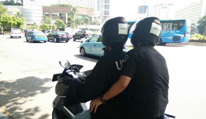Foto Berita Pengamat ini Pertanyakan Sistem Tarif Batas Bawah Taksi Online