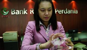 Foto Rupiah Kamis Pagi di Posisi Rp13.022