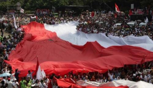 Foto Waduh! Bendera Indonesia Terbalik di Buku Panduan SEAG