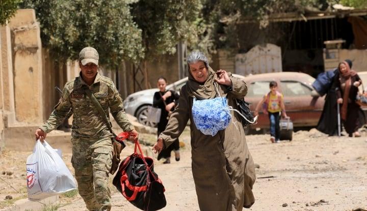Foto Berita Rusia: 300 Warga Sipil Berhasil Keluar dari Ghouta