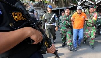 Foto Kepolisian Tangkap Pengedar Ganja di Perbatasan RI-PNG