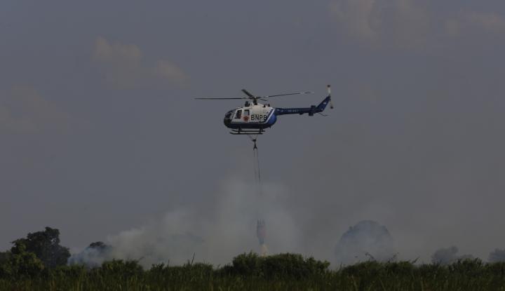 Foto Berita Antisipasi Asap di Asian Games Palembang, BPPT Sebar 24 Butir Flare