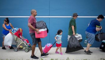 Foto Ketika Lebih dari 7000 Orang 'Menyerbu' Amerika Serikat