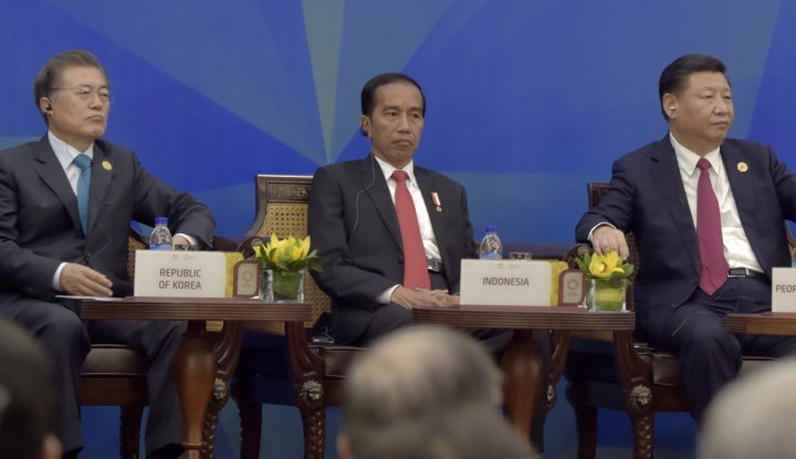 Foto Berita Terbang ke Korsel, Jokowi Temui Presiden Moon