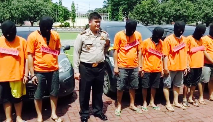 Foto Berita Curangi Grab, 7 Sopir Taksi Online Terancam 12 Tahun Penjara