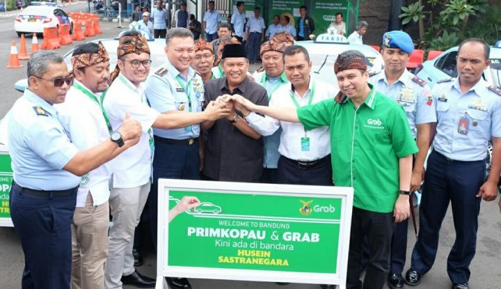 Foto Berita Grab Resmikan Layanan Penjemputan di Bandara Husein Sastranegara