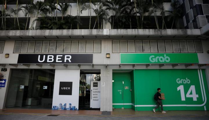 Foto Berita Singapura Siapkan Kebijakan Sementara Terkait Kesepakatan Uber-Grab