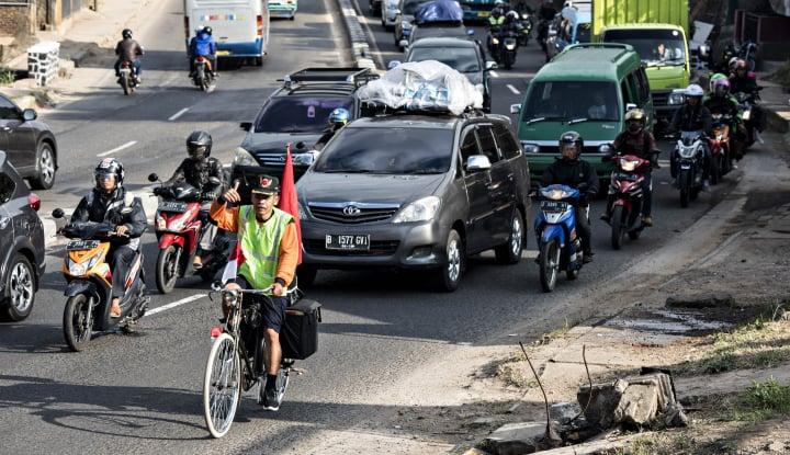 Foto Berita Demi Mudik ke Kampung Halaman, Pria Ini Gowes Sepeda Sejauh 704 Km