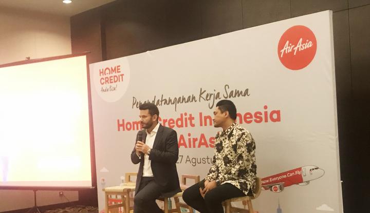 Foto Berita Gandeng AirAsia, Home Credit Beri Kredit untuk Tiket Pesawat