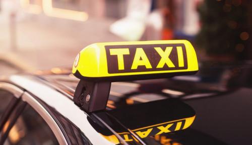 Foto Iklan Interaktif Hadir di TV Kursi Belakang Taksi Online