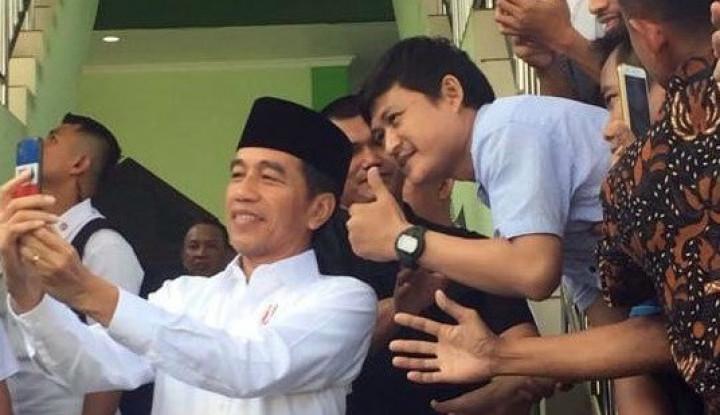 Guru Les Pengunggah Turunkan Foto Presiden Jokowi Ditahan - Warta Ekonomi