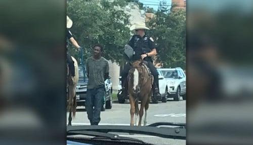 Foto 2 Petugas Polisi di Amerika Seret Pelaku Kriminal Pakai Kuda Banjir Kecaman