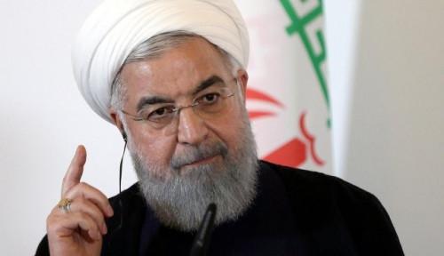 Foto Presiden Iran: Kami Tak Akan Bertekuk Lutut pada AS