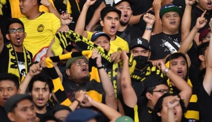 Dengan Muka Lebam, Korban Pengeroyokan Suporter Malaysia Buka Suara - Warta Ekonomi