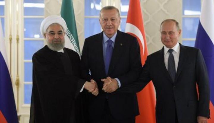 Vladimir Putin Kutip Ayat Al Quran Saat Pidato Bersama Rouhani dan Erdogan - Warta Ekonomi