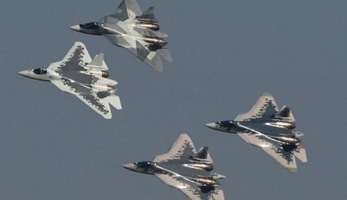 Foto Atas Perintah Putin, Menhan Rusia Terbang Dikawal Jet Tempur Temui Bashar Al-Assad