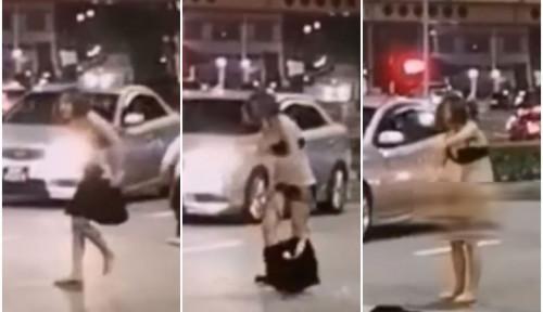 Foto Polisi Tangkap Wanita Tanpa Busana di Jalanan Singapura, Begini Ceritanya
