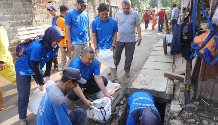 Antisipasi Banjir, Bukopin-Pemkot Jaksel Gelar Program Bersih-Bersih - Warta Ekonomi