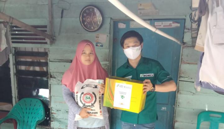 HUT Ke-20 di Tengah Pandemi, Monex Medan Bagi-Bagi Sembako untuk Masyarakat