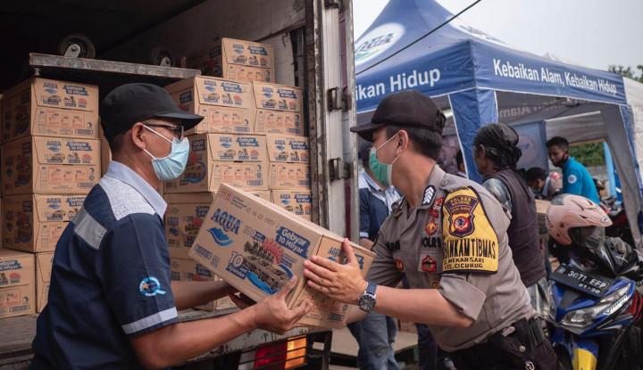 Danone-AQUA Salurkan Bantuan Korban Banjir Bandang di Sukabumi