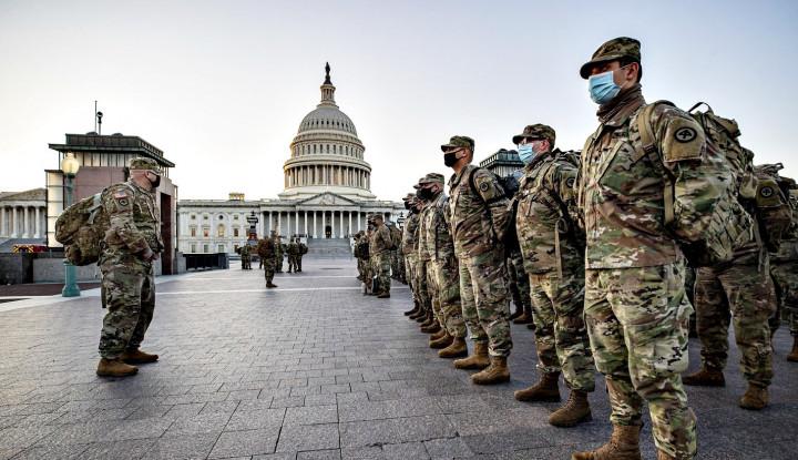 Lewat Ramalan QAnon, AS Perketat Keamanan Gedung Capitol karena Takut...