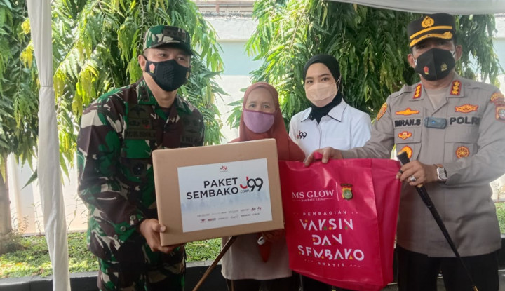 Duet Bareng Polres Depok, J99 Corp Gelar Vaksin Gratis dan Bagi-Bagi Sembako
